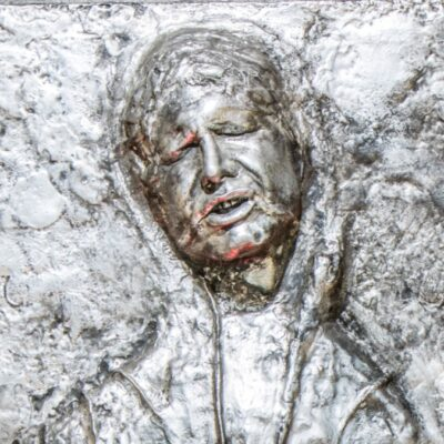 Star Wars Han Solo played by Harrison Ford frozen in carbonite