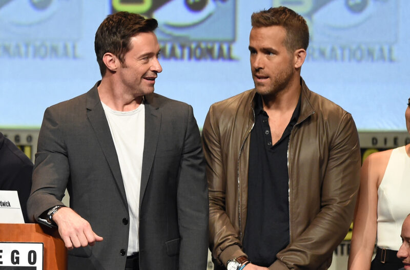 Hugh Jackman on the left, joking with Ryan Reynolds at Comic Con