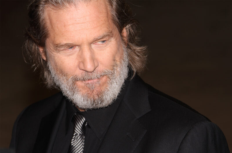 Jeff Bridges with a beard, looking serious.