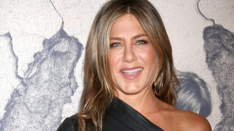 Jennifer Aniston wears a black dress on the red carpet