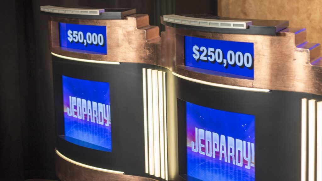 Two Jeopardy! podiums stand empty on the set of the popular game show