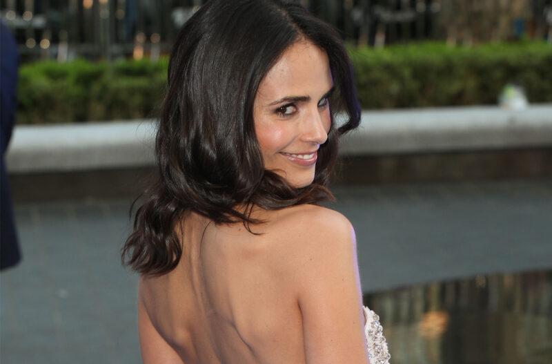 Jordan Brewster in a backless dress, looking over her shoulder.