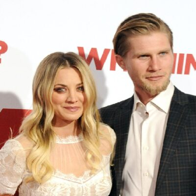 Kaley Cuoco stands with Karl Cook on the red carpet