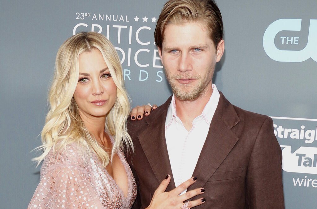 Kaley Cuoco on left, standing with Karl Cook