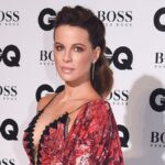 Kate Beckinsale wears a red floral dress on the red carpet