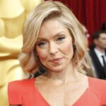 Kelly Ripa wears a red dress on the red carpet