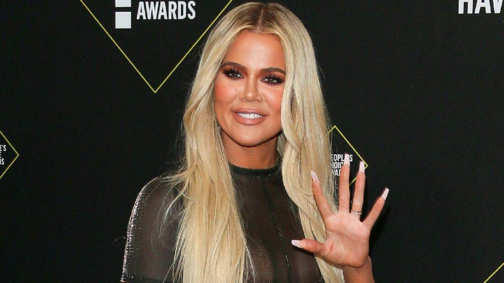 Khloe Kardashian wears a black mesh dress on the red carpet