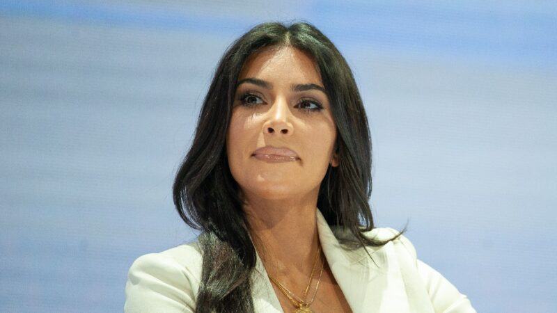 Kim Kardashian wears a white suit jacket while visiting Armenia