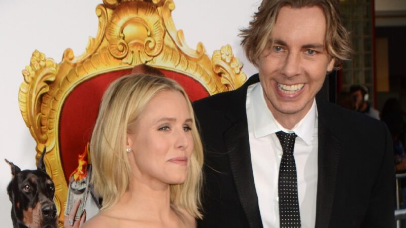 Kristen Bell and husband Dax Shepard pose together while walking the red carpet