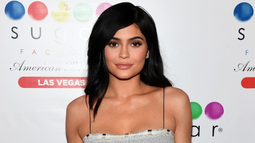 Kylie Jenner wears a gray stripped dress on the red carpet