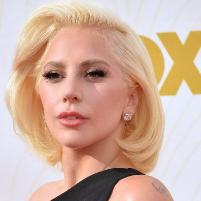 Lady Gaga wears a black dress on the red carpet