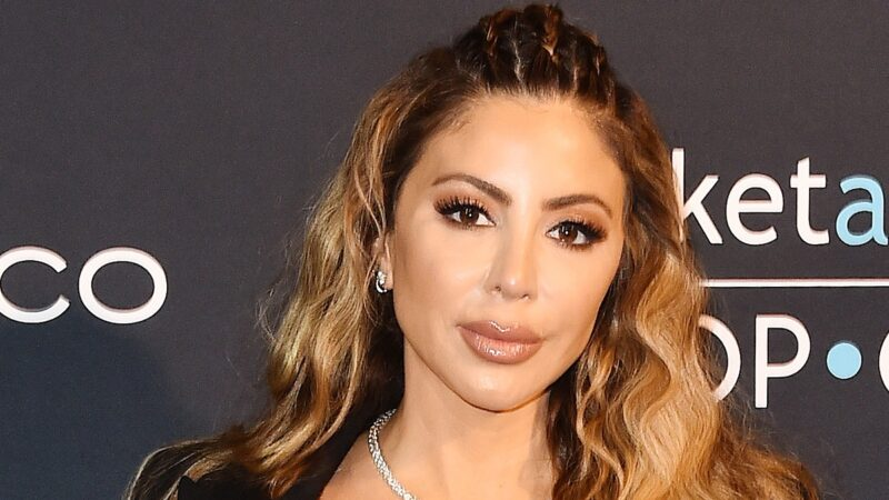 Larsa Pippen wears a black top and pants on the red carpet