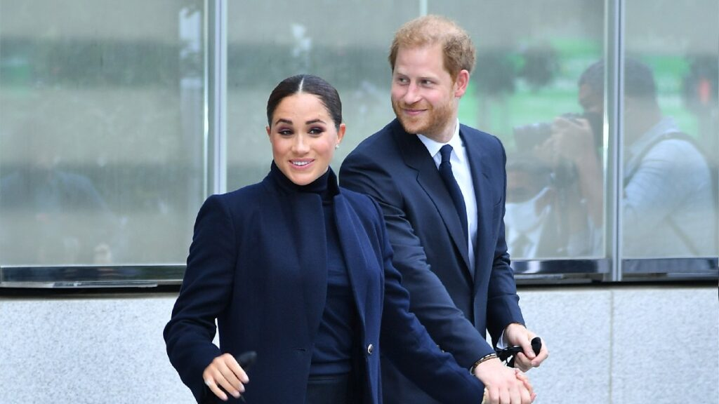 Meghan Markle and Prince Harry, both dressed in dark blue, visit New York City