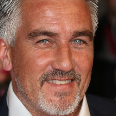 Paul Hollywood wears a dark suit on the red carpet
