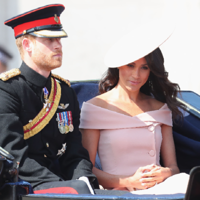 Prince Harry and Meghan Markle ride together in a carriage