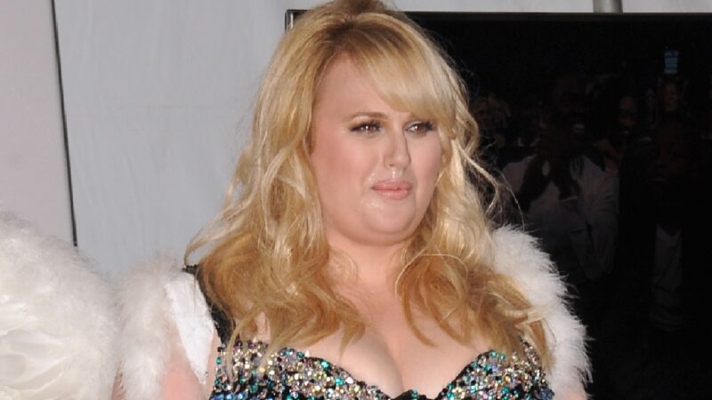 Rebel Wilson wears a black brassiere and white angel wings at the MTV Awards