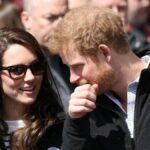 Kate Middleton and Prince Harry wear matching black jackets at an outdoor royal event
