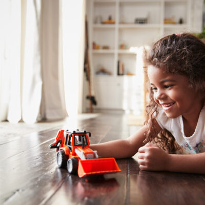 Image of girl playing with fire truck
