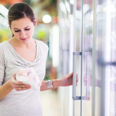 Image of woman gettin frozen chicken