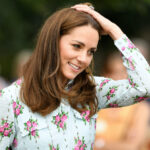 Kate Middleton with hand on head in a floral dress