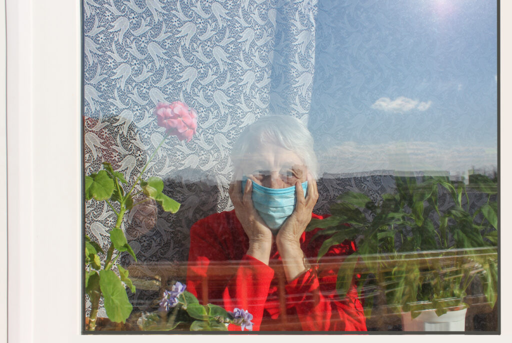 Image of old woman with mask on