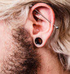 Profile of man with an industrial piercing.