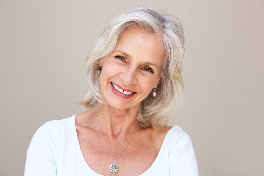 Close,Up,Portrait,Of,Beautiful,Older,Woman,Smiling,And,Standing