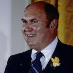 Willard Scott smiling in a blue suit in 1986