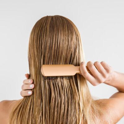 Image of woman brushing hair