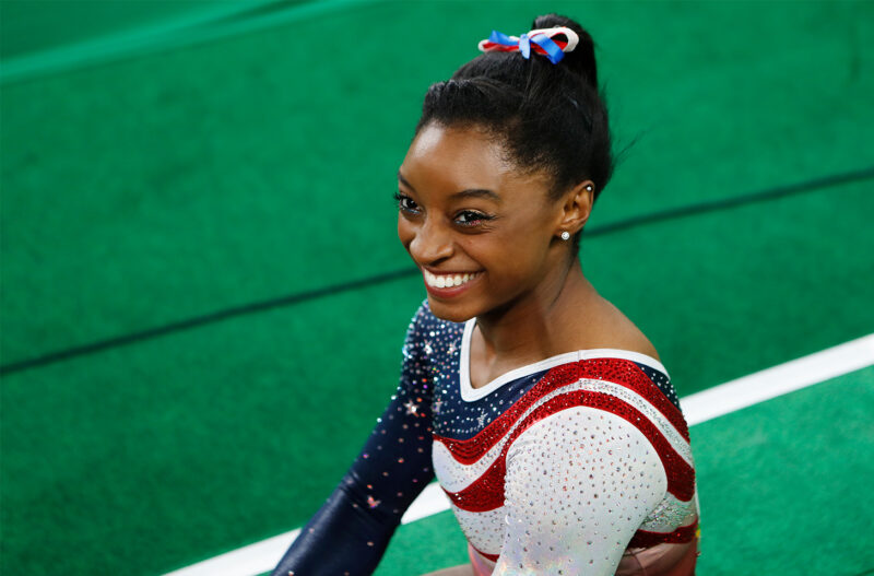 Simone Biles smiling at the Olympics