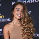 Sommer Ray wears a brown dress on the red carpet