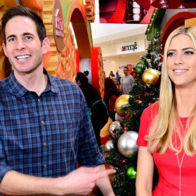 Tarek El Moussa points to Christina Haack during a Christmas photoshoot