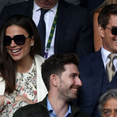 Hayley Atwell on the left, sitting with Tom Cruise at Wimbledon