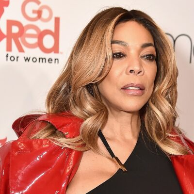 Wendy Williams wears a red jacket over a black dress on the red carpet