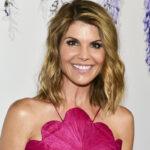 Lori Loughlin smiling in a pink dress