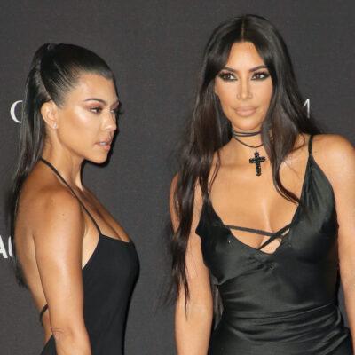 Kourtney Kardashian and Kim Kardashian in black dresses