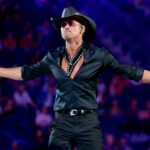 Tim McGraw in a black outfit on stage