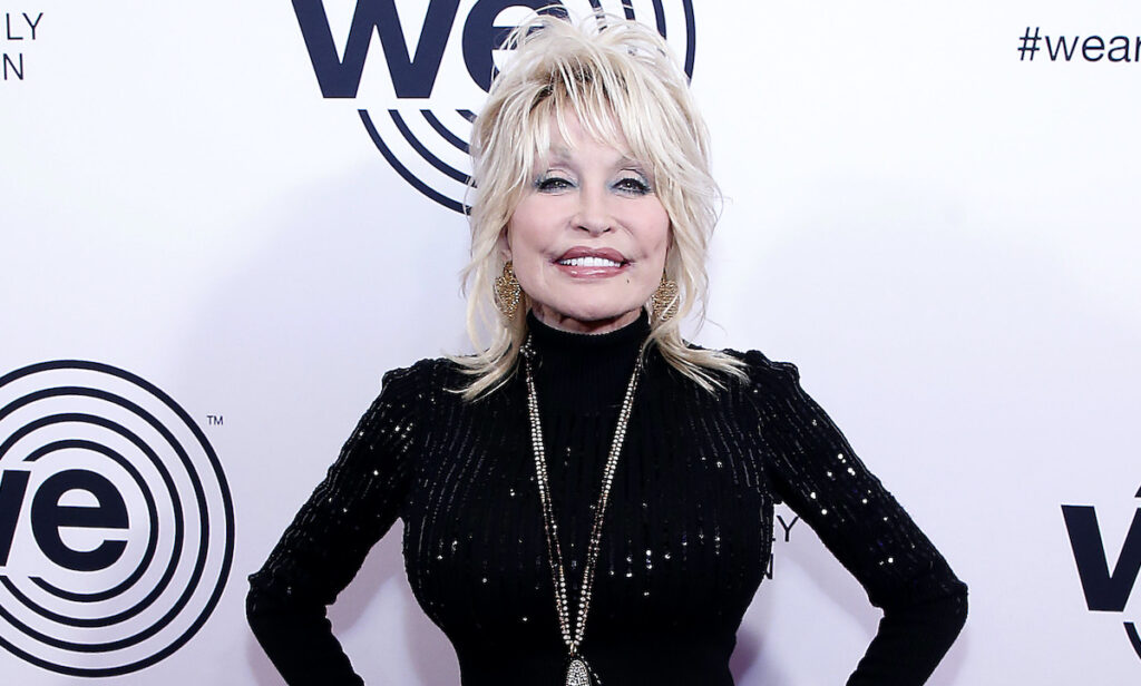 Dolly Parton smiling in a black blouse