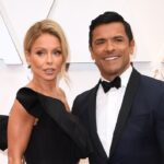 Kelly Ripa in a black dress with Mark Consuelos in a tux