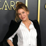Renee Zellweger in a white shirt and black jacket