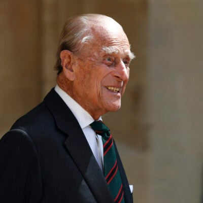Prince Philip smiling in a black suit