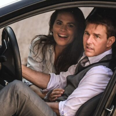 Hayley Atwell smiling in a car with Tom Cruise
