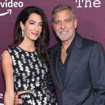 Amal Clooney in a silver and black dress with George Clooney in a grey suit