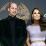 Prince William in a green suit with Kate Middleton in a white dress