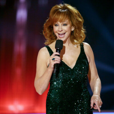 Reba McEntire singing in a green dress
