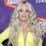 Carrie Underwood in a yellow outfit