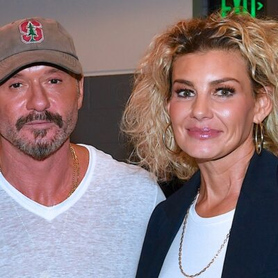 Tim McGraw in a white shirt with Faith Hill in a blue jacket