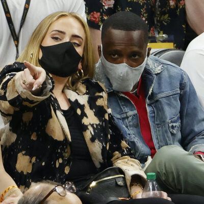 Adele and Rich Paul sitting courtside at a Lakers game