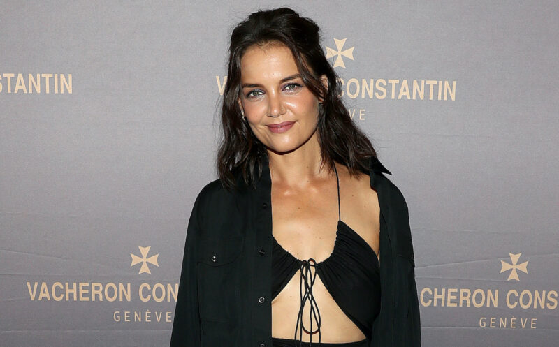 Katie Holmes smiling in a black outfit