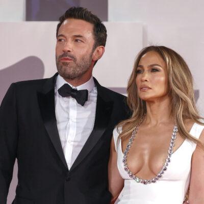 Ben Affleck in a tuxedo with Jennifer Lopez in a white dress